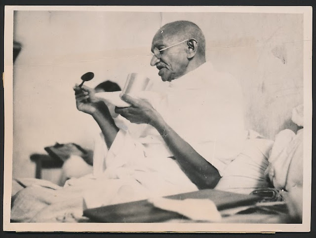 Mahatma Gandhi taking his last meal before the start of his fast - 1939